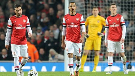 Arsenal's players show their dejection after Bayern Munich romped to a first leg victory in the Cham