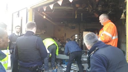 Police search a scrap metal yard for stolen goods