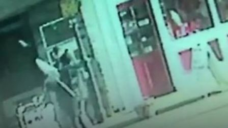 CCTV captures thieves stealing giant novelty lollipop from Lowestoft sweet shop. Picture Archant.