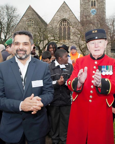 Cllr Muhammed Butt, leader of Brent Council, with a Chelsea pensioner