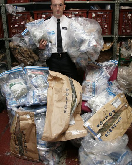 Superindentent Simon Rose of Brent Police shows the quanitity of cannabis seized over roughly a thre