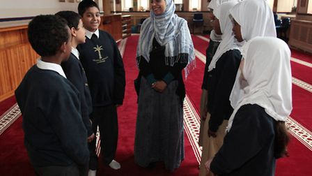 Good Ofsted at Islamia Primary School, head teacher Zahida Shaheem is pictured with students