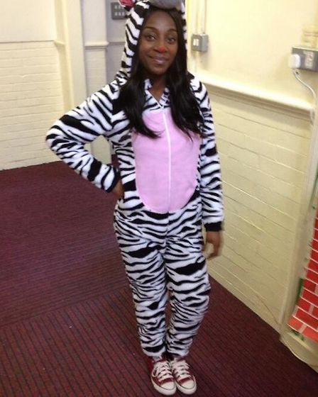 Teacher Miss Sadiat wore a onesie for Red Nose Day