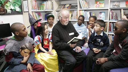 Author Chris Powling with pupils at the opening of the new library