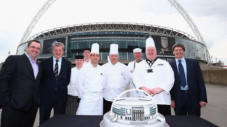 England manager Roy Hodgson took to Wembley Way with stadium staff to cut a giant cake made for the