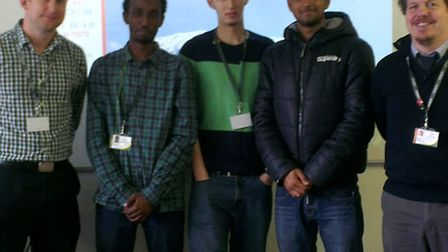 Pupils; Najeeb Jama, Younes Berrazouane and Mohammad Mansoor with Kevin Lynch, science teacher and S
