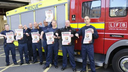 angry fire fighters standing in front of their station Clerkenwell which has served the community fo