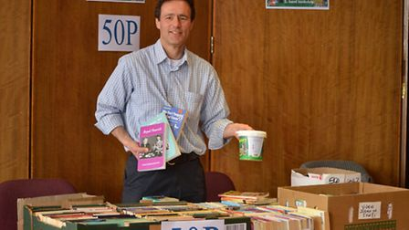 Liberal Democrats Councillor Paul Lorber at the Friends of Barham Library book stall.
