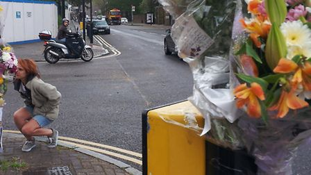 Flowers alongside tributes were left at the crash scene by friends