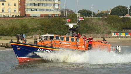 The Spirit of Lowestoft lifeboat passing CEFAS as she left the town for the final time in 2014. Pict
