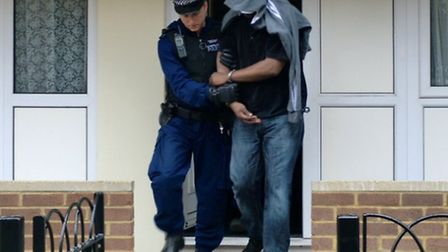 A suspect being arrested at his home in Westminster