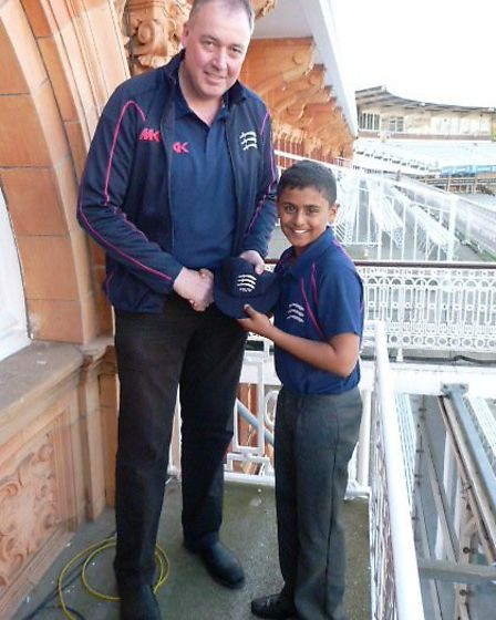 Former Middlesex and England player Angus Fraser presents Panav Patel with his cap