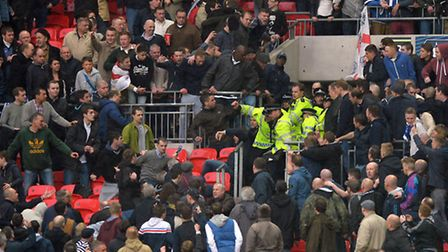 Police deal with fighting Millwall fans during the FA Cup at the Semi Final at Wembley Stadium (pic