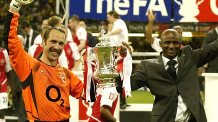 Arsenal's David Seaman (left) and Patrick Vieira with the FA Cup in 2003