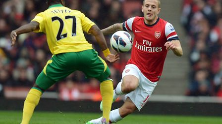 Norwich's Alex Tettey in action against Jack Wilshere. Photo: Anthony Devlin/PA