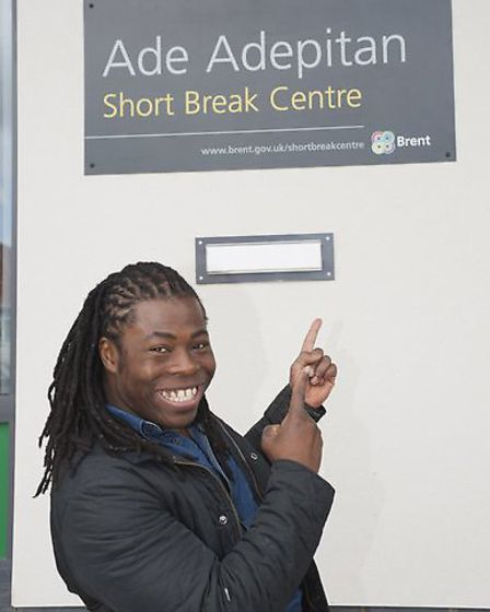 Ade Adepitan at the entrance to the short break centre.