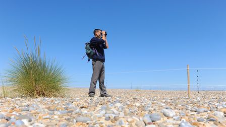 A volunteer warden keeps an eye on the little tern colony nesting at Kessingland beach during a prev