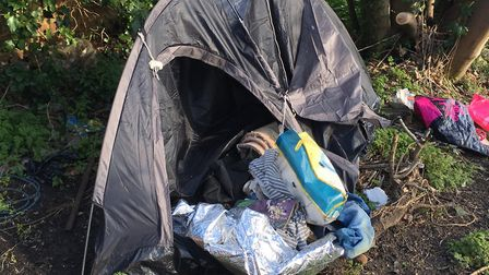 Masses of fly-tipped rubbish sits on a plot of land behind Lowestoft High Street. Picture: Thomas Ch