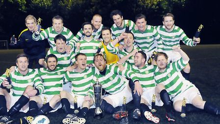 St Paul's Celtic celebrate their victory in the Islington Gazette Cup final as the Division One side