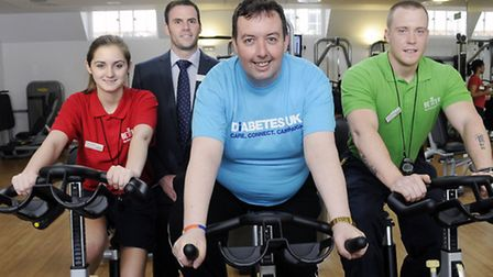 Pictured from left on exercise bikes from left is recreation assistant Rosie Liddiard, Cllr Troy Gal