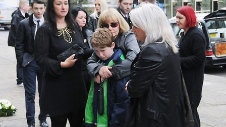 GRIEVING: Mother bridget, centre, clutches Michael's nephew, Dylan, in grief