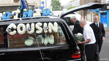 TRIBUTES: Flowers spelling 'Son', 'Cousin' and 'Nephew' decked the hearse