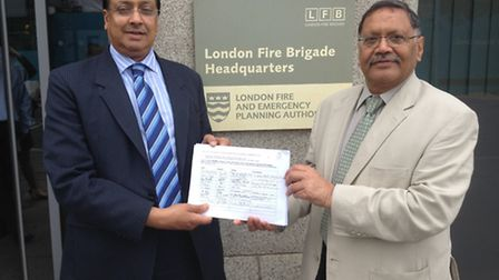 Cllr Aslam Choudry and Navin Shah with the petition