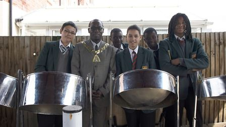 Cllr Bobby Thomas, Brent Mayor, with members of Newman Catholic College steel band