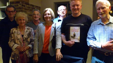 Alan Monaghan, holding his novel, with members of the Friends of Preston Library