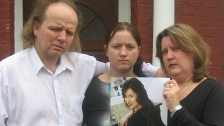 The family of Paula Jurek hold her photograph. Pictured (from left) are her father Zbigniew, sister