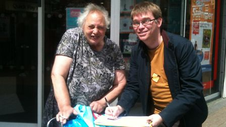 Resident Katie Gray signs the petition launched by James King