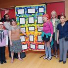 """People from the Stuart Low Trust unveils their """"poetry quilt"""""""