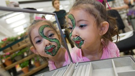 Eleanor Cambridge has her face painted at Marks & Spencer Holloway Road's centenary celebrations