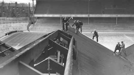 Workers on the old stand at Highbury in 1936