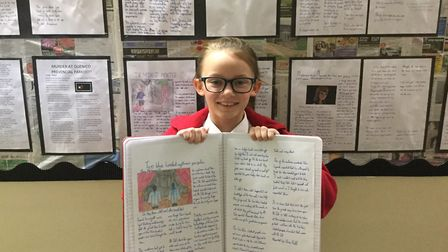 Journalist Emma Moylan visited Poplars Primary School in Lowestoft. Year six pupil Olivia with her n