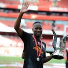 Galatasaray's Didier Drogba celebrates with the Emirates Cup. Photo: PA Wire.