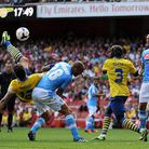 Arsenal's Olivier Giroud scores his team's first goal against Napoli. Photo: PA Wire.