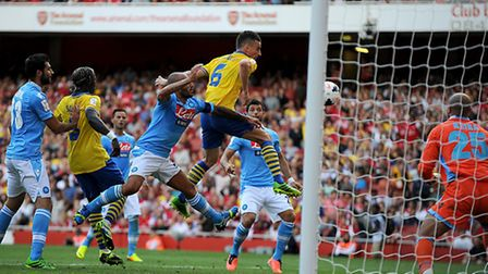 Arsenal's Laurent Koscielny scores his team's equaliser against Napoli during the Emirates Cup 2013
