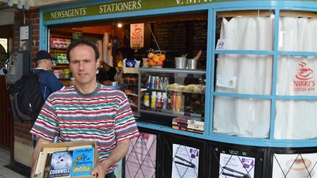 Cllr Paul Lorber delivers books to Nikki's Coffee Bar in Sudbury