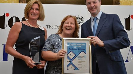 Head teacher Lynne Gavin, Centre, and chair of Govenors, Nicola Manby, are crowned national pupil pr