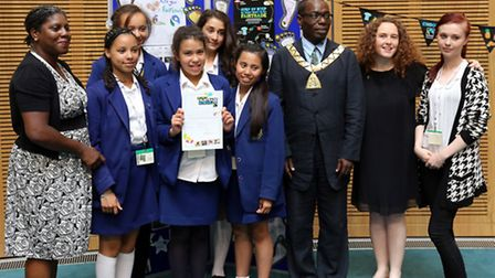 Pupils and teachers from the Convent of Jesus and Mary Language College were presented with a certi