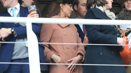 Duke and Duchess of Cambridge watch the first race on Gold Cup Day, during Cheltenham Festival.
