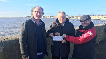 Neil Gariock hands Danny Steel and Trevor Blowers the £1,000 cheque for Lowestoft South Pier. Photo:
