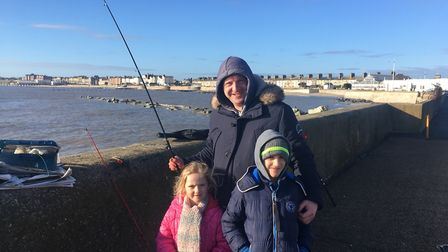 The Despalueas family, from London, enjoy a spot of fishing on Lowestoft South Pier. Photo: James Ca
