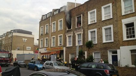 Smoke bellowed from the Tollington Way flat after it became engulfed