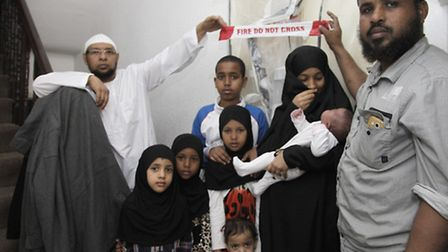 The Mukhtar children and (left to right) Mohamed, Faduma and Sayid Mukhtar. Picture: Jan Nevill