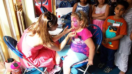 Charlotte O'loughlin, five, having her face painted at the Summer Time Fun Day (pic credit: Jonathan