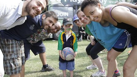 Christopher Zaug, 5, with players from Kilburn Cosmic rugby club (Pic credit: Jan Nevill)