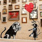 The mirror-covered garden wall boasts a fetching Banksy copy