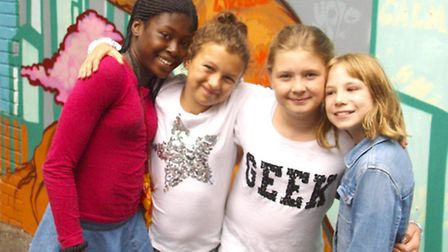 Emmanuella, Sydnee, Ronnierose and Mia in front of a mural they helped to paint Pic: Tony Gay